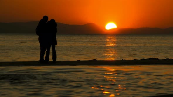 Thumbnail for Young Couple Taking Selfie Near The Sea In Sunset