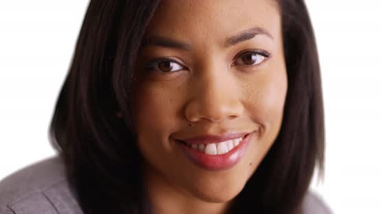 Thumbnail for Close up of beautiful black female with bright, cheerful smile in studio