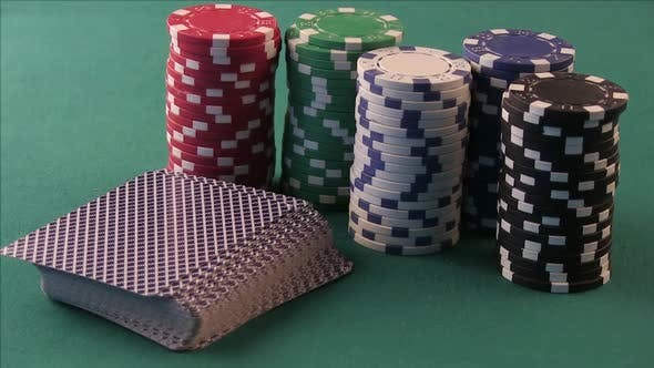 Poker Chips And Playing Cards On The Poker Table