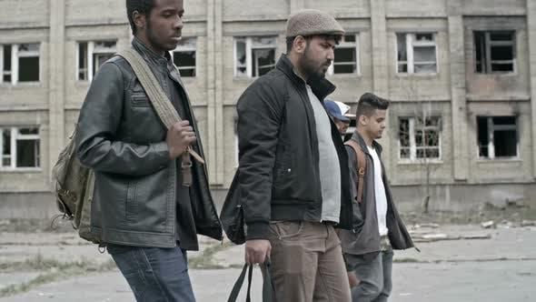 Thumbnail for Arab Men Walking in Refugee Camp