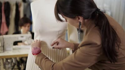 Creative Fashion Designers are Working Together in the Tailor Studio