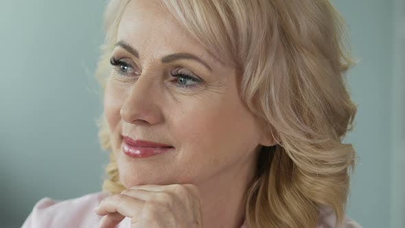 Thumbnail for Advertising of Anti-Age Cosmetics. Attractive Mature Woman Smiling Into Camera