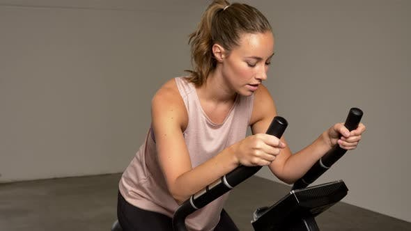 Thumbnail for Athlete Woman Exercising on a Stationary Bike