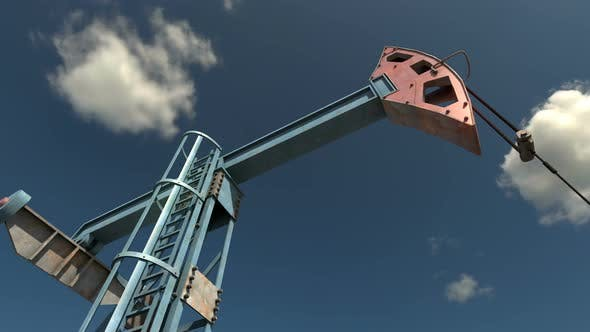 Thumbnail for Low Angle View of Oil Pump Jack Working and Pumping Crude Oil under Blue Sky