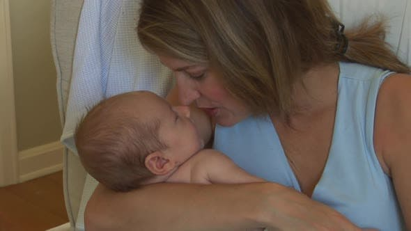 Thumbnail for Mother holding newborn