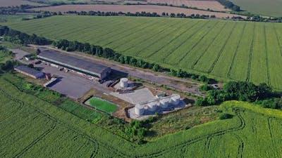 Camera Flight Over Farm in Fields