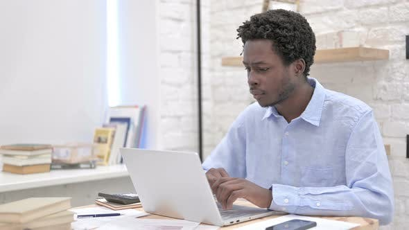 Thumbnail for Excited African Man Working on Laptop