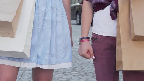 Thumbnail for Cropped Shot of Two Female Friends Holding Hands