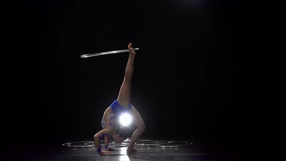 Thumbnail for Girl Exercises with a Gymnastic Hoop . Black Background