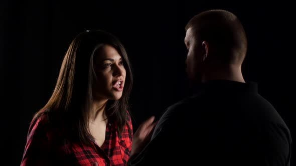 Thumbnail for Close-up of Woman Arguing with Her Boyfriend on Black Background