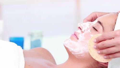 Woman Enjoying a Facial Treatment