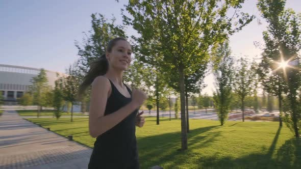 Thumbnail for Sports Woman Makes Morning Jog and Physical Exercises In  Park