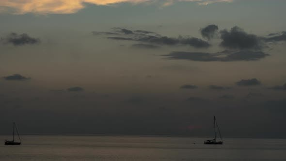 Yacht at Dusk Clouds Float in the Sky