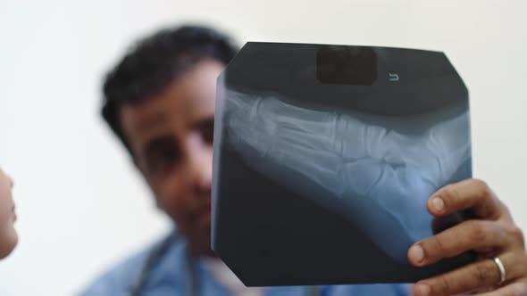 Thumbnail for Doctor Explaining Leg Injury to Little Girl