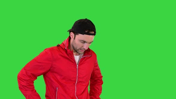 Sportsman Walking and Having a Heart Pain on a Green Screen Chroma Key