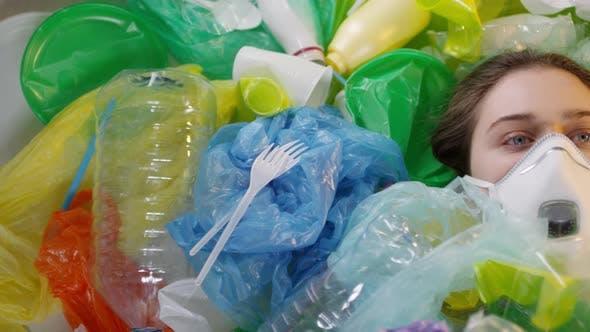 Thumbnail for Girl In Respiratory Mask Lying in Plastic