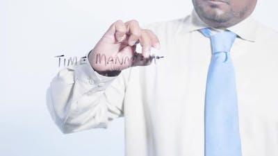 Latino Businessman Writes Time Management