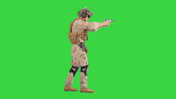 Thumbnail for Special Operations Training Soldier Walking and Shooting From Hand Gun on a Green Screen, Chroma Key