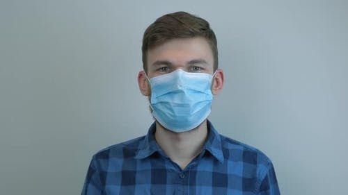 Portrait of caucasian man in medical face mask. Virus protection. Pandemic.