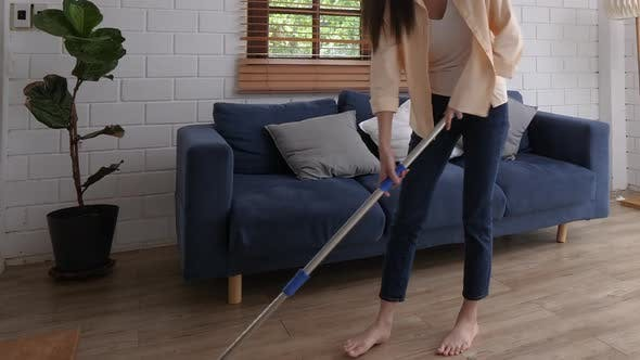 Girl Cleaning on Floor at Hose