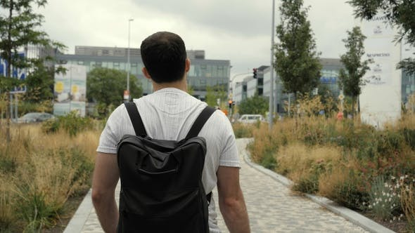 Thumbnail for Adult Caucasian Man with Backpack Walking on Street In