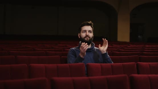 Cover Image for Man Watching a Theater Performance Alone
