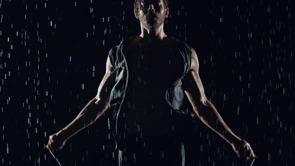Thumbnail for Athletic Man Jumping Rope In The Rain