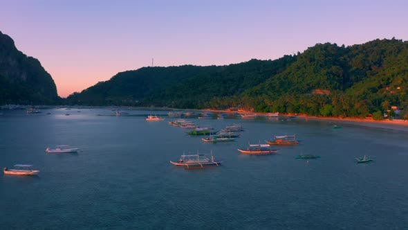 Thumbnail for Sail Boats at Sunset on the Sea Lagoon on Corong Beach in El Nido, Palawan, Philippines.