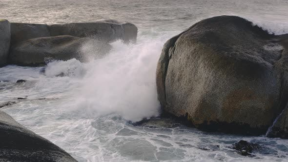 Thumbnail for Big Waves Turn Into White Foamy Water After Hitting a Group of Giant Boulders