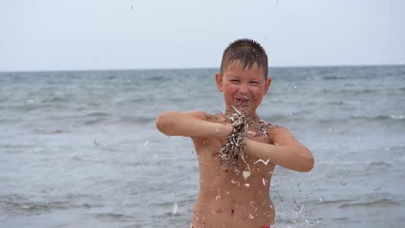 Thumbnail for Beach Summer Vacation. Children's Emotions. The Child Develops Tinsel in the Wind.