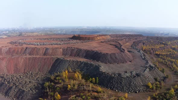 Huge Mounds of Waste Iron Ore Near the Quarry
