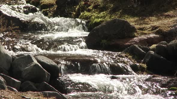 Small Waterfall flowing down Mountain Side in Argentine Patagonia.