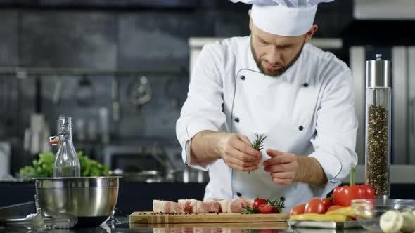 Thumbnail for Male Chef Seasoning Meat in Slow Motion. Portrait of Cook Seasoning Steak