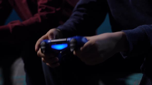 Closeup Hands of Boy Holding Game Controller