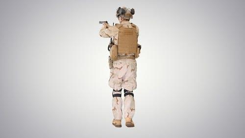 Ranger in Full Combat Uniform Walking on Gradient Background