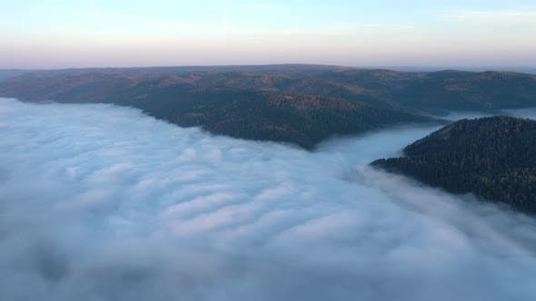 Aerial Hyperlapse of Mist Flow in a Mountain Gorge at Dawn