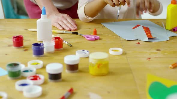 Thumbnail for Close Up of Hands of Kids Painting and Making Paper Crafts in Art Class
