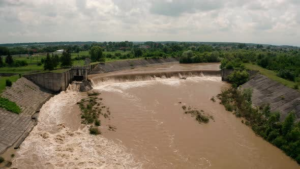 Thumbnail for Aerial Drone View. River Water Move Down From with a Water Filled Dam After Heavy Floods and Rains.