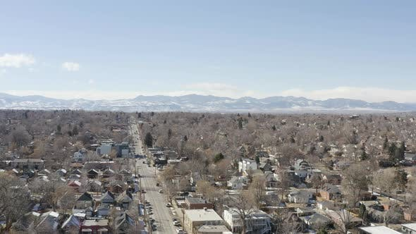 Thumbnail for Denver Co Aerial Rising Up Shot Street Heading Toward Rocky Mountains