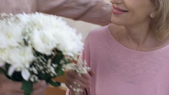 Thumbnail for Senior Man Giving Flowers Bunch to Aged Woman, Happy Retired Couple, Anniversary