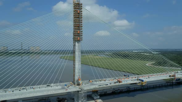 Rising Aerial View of a Cable Stayed Bridge in the Late Construction Phase