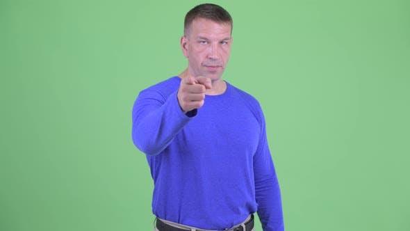 Thumbnail for Serious Macho Mature Man Pointing at Camera