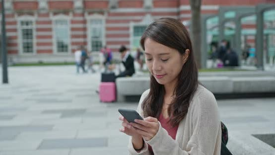 Thumbnail for Woman use of mobile phone in Tokyo city