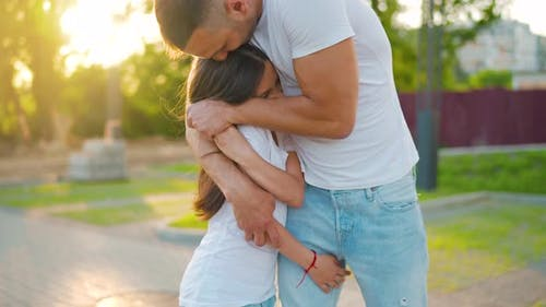 Father Hugs Daughter