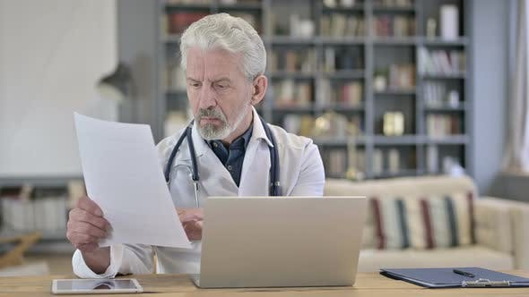 Thumbnail for Senior Old Doctor Reading Medical Documents in Clinic