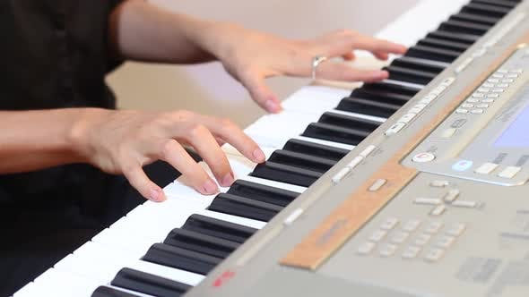 Thumbnail for Womanl Playing on Electric Piano