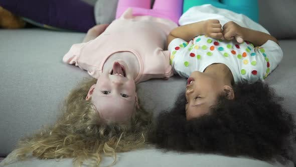Thumbnail for Happy Multiracial Kids Lying on Couch and Having Fun, Childhood and Holidays