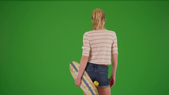 Thumbnail for Woman skater with skateboard standing waiting for friends on green screen