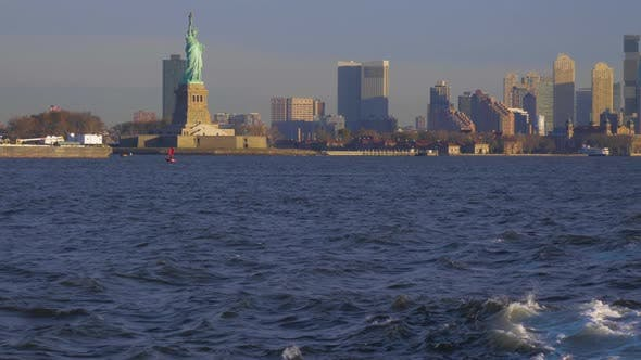 Cover Image for Statue of Liberty and Urban Cityscape in the Morning. New York City. View From the Water