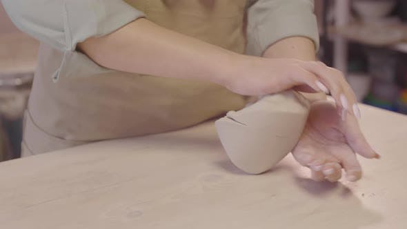 Craftswoman Kneading Clay